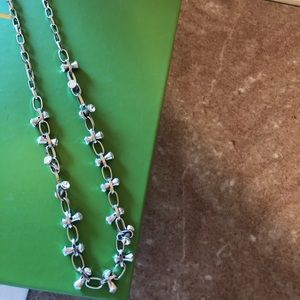 Silver colored statement necklace